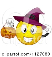 Cartoon Of A Halloween Witch Emoticon Holding A Pumpkin Bucket Royalty Free Vector Clipart