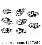 Clipart Of Black And White Soccer Balls With Tribal Flames Royalty Free Vector Illustration
