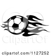 Clipart Of A Black And White Soccer Ball With Tribal Flames 6 Royalty Free Vector Illustration