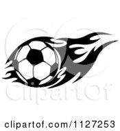 Clipart Of A Black And White Soccer Ball With Tribal Flames 5 Royalty Free Vector Illustration