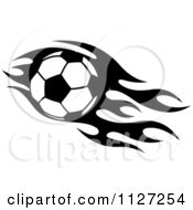 Clipart Of A Black And White Soccer Ball With Tribal Flames 4 Royalty Free Vector Illustration