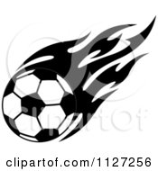 Clipart Of A Black And White Soccer Ball With Tribal Flames 2 Royalty Free Vector Illustration