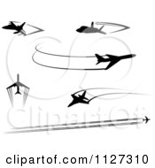 Clipart Of Black Silhouetted Airplanes And Trails Royalty Free Vector Illustration