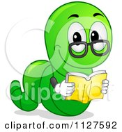 Cartoon Of A Worm Reading A Book Royalty Free Vector Clipart
