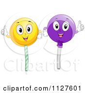 Cartoon Of Happy Loli Pop Mascots Holding Thumbs Up Royalty Free Vector Clipart