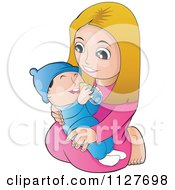 Happy Mother Or Girl Kneeling And Holding A Baby