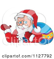Cartoon Of Santa Carrying A Bag And Presenting Over A Surface Royalty Free Vector Clipart