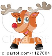 Cartoon Of A Cute Christmas Reindeer Over A Sign Royalty Free Vector Clipart by visekart