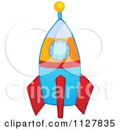 Cartoon Of A Toy Rocket Royalty Free Vector Clipart by visekart