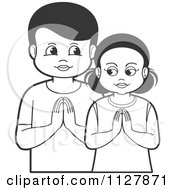 Clipart Of A Black And White Boy And Girl Praying Royalty Free Vector Illustration