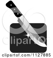 Clipart Of A Kitchen Knife And Board Royalty Free Vector Illustration