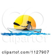 Silhouetted Woman Kayaking At Sunset