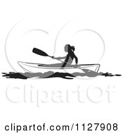 Clipart Of A Black And White Silhouetted Woman Kayaking Royalty Free Vector Illustration by Lal Perera