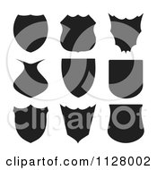 Clipart Of Black Shield Silhouettes Royalty Free Vector Illustration by michaeltravers