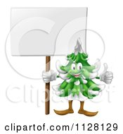 Cartoon Of A Happy Christmas Or Evergreen Tree Mascot Holding A Sign And Thumb Up Royalty Free Vector Clipart