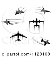 Clipart Of Black Silhouetted Airplanes And Contrails Royalty Free Vector Illustration