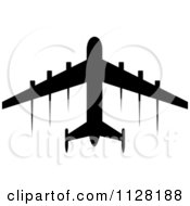 Clipart Of A Black Silhouetted Airplane And Contrails 3 Royalty Free Vector Illustration