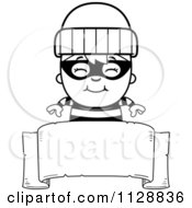 Cartoon Of A Black And White Happy Robber Boy Over A Banner Sign Vector Clipart