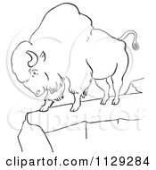 Cartoon Clipart Of An Outlined Bison On A Cliff Black And White Vector Coloring Page
