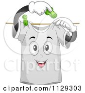Cartoon Of A Happy Shirt Mascot Hanging Itself On A Line Royalty Free Vector Clipart