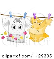 Cartoon Of Happy Shirt Mascots Together On A Clothesline Royalty Free Vector Clipart