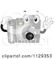 Cartoon Of A Digital Camera Mascot Holding Up Fingers And Pushing A Button Royalty Free Vector Clipart