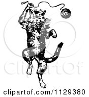 Clipart Of A Retro Vintage Black And White Cat Playing With Yarn Royalty Free Vector Illustration