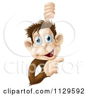 Cartoon Of A Happy Monkey Smiling And Pointing To A Sign Royalty Free Vector Clipart
