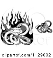 Clipart Of Black And White Snakes With Flames Royalty Free Vector Illustration