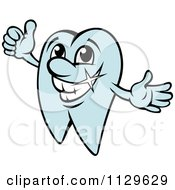 Clipart Of A Happy Blue Tooth Mascot Holding A Thumb Up Royalty Free Vector Illustration