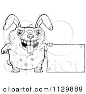 Cartoon Clipart Of An Outlined Ugly Rabbit Holding A Sign Black And White Vector Coloring Page by Cory Thoman