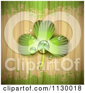 Clipart Of A Dewy Shamrock Clover On Wood Grain With Green Grunge Royalty Free Vector Illustration