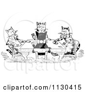 Clipart Of Retro Vintage Black And White Cats Playing Cards Royalty Free Vector Illustration