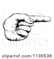 Clipart Of A Black And White Retro Woodcut Hand Pointing A Finger Royalty Free Vector Illustration