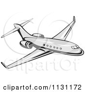 Clipart Of A Retro Commercial Airliner Plane Royalty Free Vector Illustration