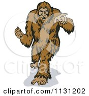 Clipart Of A Retro Bigfoot Walking Forward And Pointing Royalty Free Vector Illustration by patrimonio