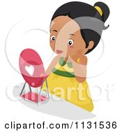 Cartoon Of A Pretty Black Girl Wearing Makeup And Looking In A Mirror Royalty Free Vector Clipart by BNP Design Studio