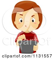 Cartoon Of A Boy Using A Tablet Computer Royalty Free Vector Clipart