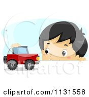 Cartoon Of An Asian Boy Playing With A Car On A Table Royalty Free Vector Clipart
