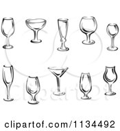 Clipart Of Black And White Cups And Glasses Royalty Free Vector Illustration