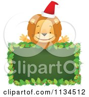 Cartoon Of A Happy Christmas Lion Over A Holly Sign Royalty Free Vector Clipart