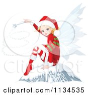 Cartoon Of A Christmas Fairy Using A Magic Wand And Sitting In Snow Royalty Free Vector Clipart by Pushkin