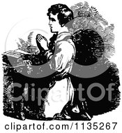 Clipart Of A Retro Vintage Black And White Boy Kneeling In Prayer Royalty Free Vector Illustration
