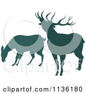 Clipart Of Silhouetted Grazing And Roaring Deer Royalty Free Vector Illustration