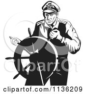 Clipart Of A Retro Black And White Steering Captain Royalty Free Vector Illustration by patrimonio