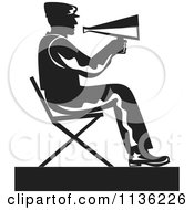 Clipart Of A Retro Black And White Film Director Sitting With A Cone Royalty Free Vector Illustration