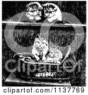 Clipart Of Retro Vintage Black And White Kittens And A Basket Royalty Free Vector Illustration