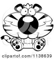 Cartoon Clipart Of An Outlined Cute Sitting Tiger Cub Black And White Vector Coloring Page