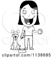 Cartoon Clipart Of A Black And White Happy Woman Feeding Her Dog Vector Outlined Coloring Page