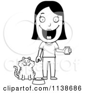 Cartoon Clipart Of A Black And White Happy Woman Feeding Her Cat Vector Outlined Coloring Page